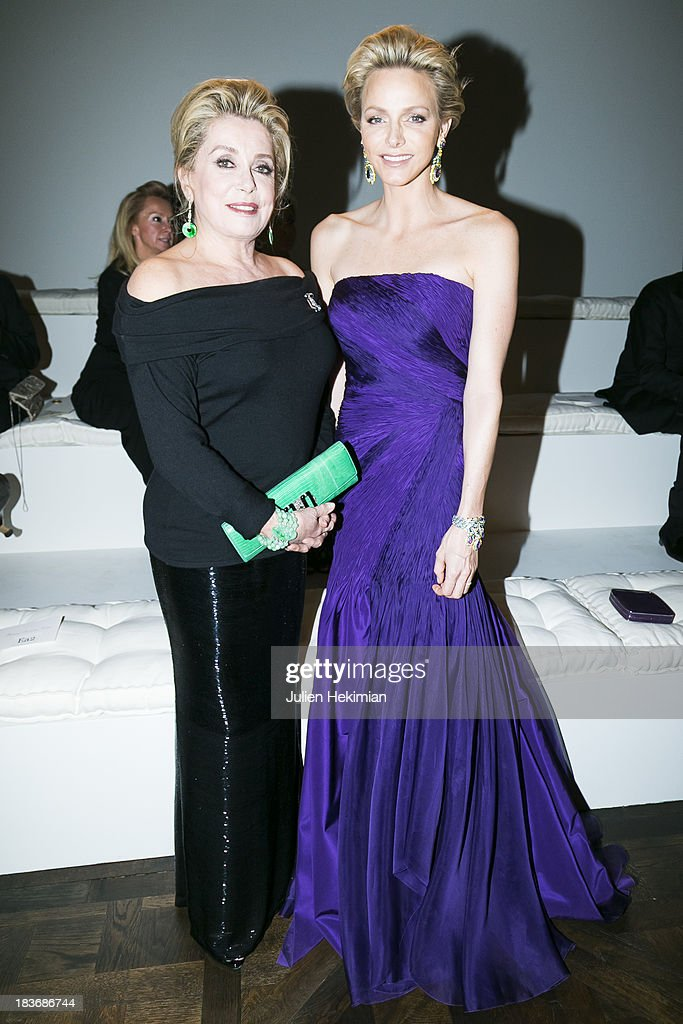 Catherine Deneuve and Princess Charlene of Monaco attend the presentation of the Ralph Lauren Fall 13 Collection Show at Les Beaux-Arts de Paris on October 8, 2013 in Paris, France. On this occasion Ralph Lauren celebrates the restoration project and patron sponsorship of L'Ecole des Beaux-Arts.