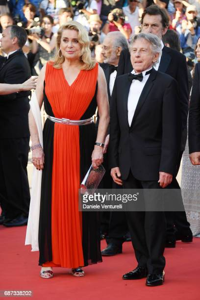 Catherine Deneuve and Roman Polanski attend the 70th Anniversary of the 70th annual Cannes Film Festival at Palais des Festivals on May 23 2017 in...