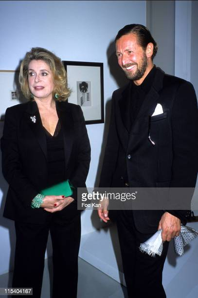 Catherine Deneuve and Stefano Pilati during Paris Fashion Week Pret a Porter Spring/Summer 2006 Dada Exhibition Preview Dinner Hosted by Yves Saint...