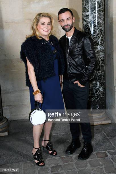 Catherine Deneuve and stylist Nicolas Ghesquiere pose after the Louis Vuitton show as part of the Paris Fashion Week Womenswear Spring/Summer 2018 on...