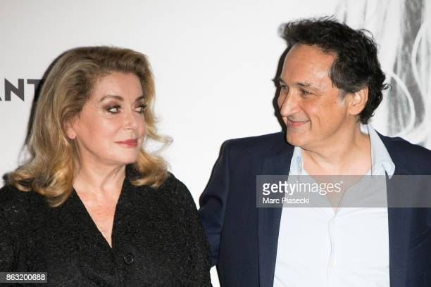Catherine Deneuve and Thierry Klifa attend the 'Tout nous separe' Premiere at UGC Cine Cite Bercy on October 19 2017 in Paris France