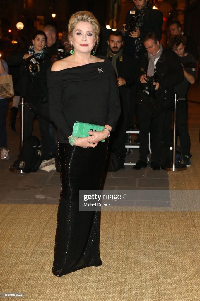 <a gi-track='captionPersonalityLinkClicked' href=/galleries/search?phrase=Catherine+Deneuve&family=editorial&specificpeople=123833 ng-click='$event.stopPropagation()'>Catherine Deneuve</a> arrives at a Ralph Lauren Collection Show and private dinner at Les Beaux-Arts de Paris on October 9, 2013 in Paris, France. On this occasion Ralph Lauren celebrates the restoration project and patron sponsorship of L'Ecole des Beaux-Arts.