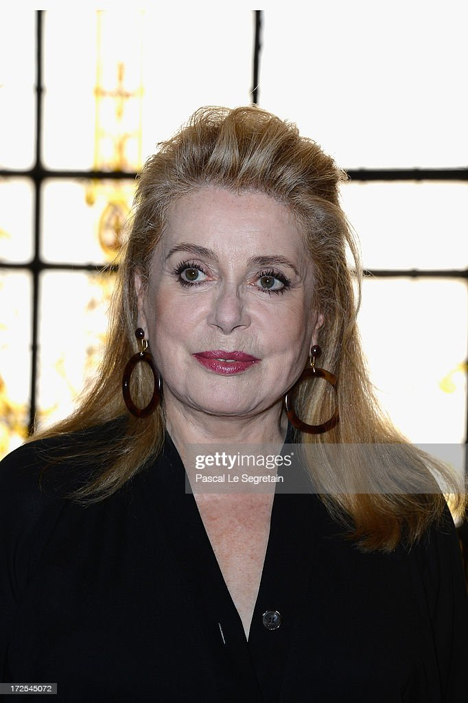 <a gi-track='captionPersonalityLinkClicked' href=/galleries/search?phrase=Catherine+Deneuve&family=editorial&specificpeople=123833 ng-click='$event.stopPropagation()'>Catherine Deneuve</a> attends the Jean Paul Gaultier show as part of Paris Fashion Week Haute-Couture Fall/Winter 2013-2014 at 325 Rue Saint Martin on July 3, 2013 in Paris, France.
