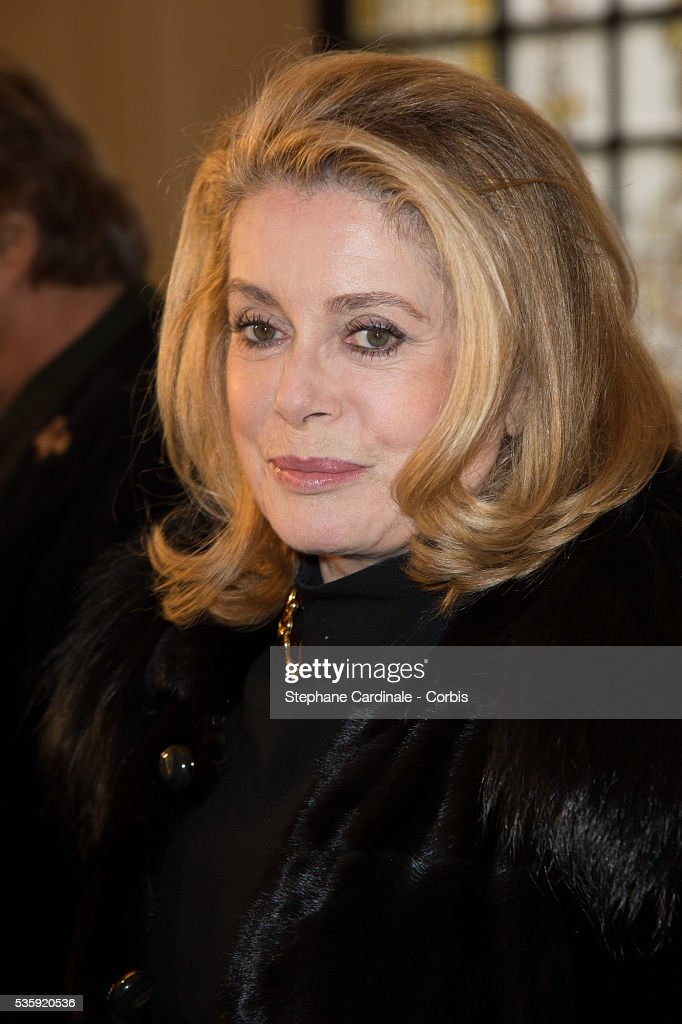 Catherine Deneuve attends the Jean Paul Gaultier show as part of Paris Fashion Week Haute Couture Spring/Summer 2014, in Paris.