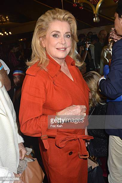Catherine Deneuve attends The Jean Paul Gaultier show as part of the Paris Fashion Week Womenswear Spring/Summer 2015 at the Grand Rex on September...