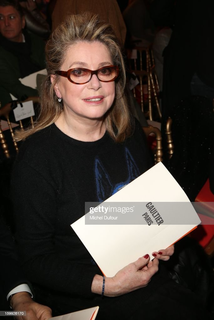 Catherine Deneuve attends the Jean-Paul Gaultier Spring/Summer 2013 Haute-Couture show as part of Paris Fashion Week at Rue Saint Martin headquarters on January 23, 2013 in Paris, France.