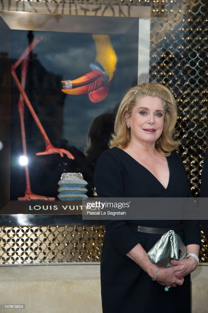 Catherine Deneuve attends the Louis Vuitton new boutique opening as part of Paris Haute-Couture Fashion Week Fall / Winter 2012/13 at Place Vendome on July 3, 2012 in Paris, France.