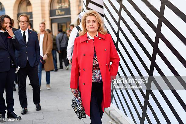 Catherine Deneuve attends the Louis Vuitton show as part of the Paris Fashion Week Womenswear Spring/Summer 2017 on October 5 2016 in Paris France