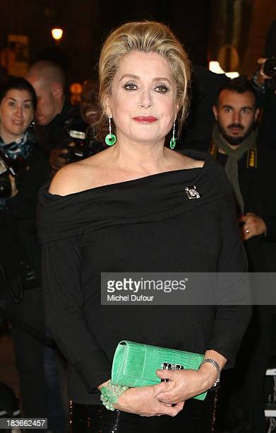 Catherine Deneuve attends the photocall at Les BeauxArts de Paris on October 9 2013 in Paris France On this occasion Ralph Lauren celebrates the...