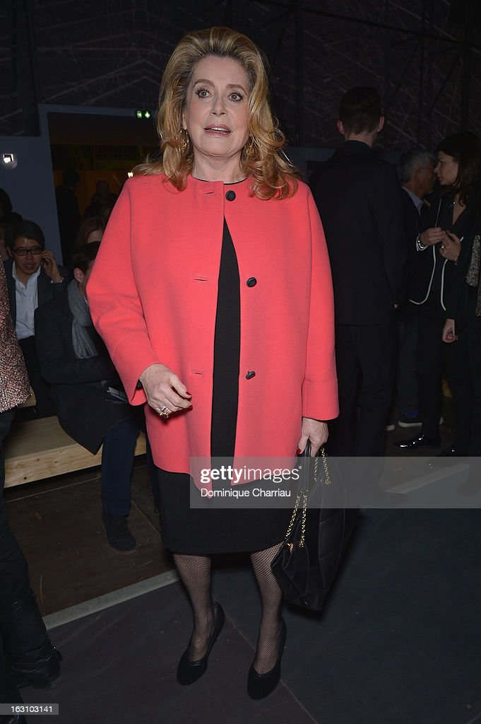 <a gi-track='captionPersonalityLinkClicked' href=/galleries/search?phrase=Catherine+Deneuve&family=editorial&specificpeople=123833 ng-click='$event.stopPropagation()'>Catherine Deneuve</a> attends the Saint Laurent Fall/Winter 2013 Ready-to-Wear show as part of Paris Fashion Week on March 4, 2013 in Paris, France.