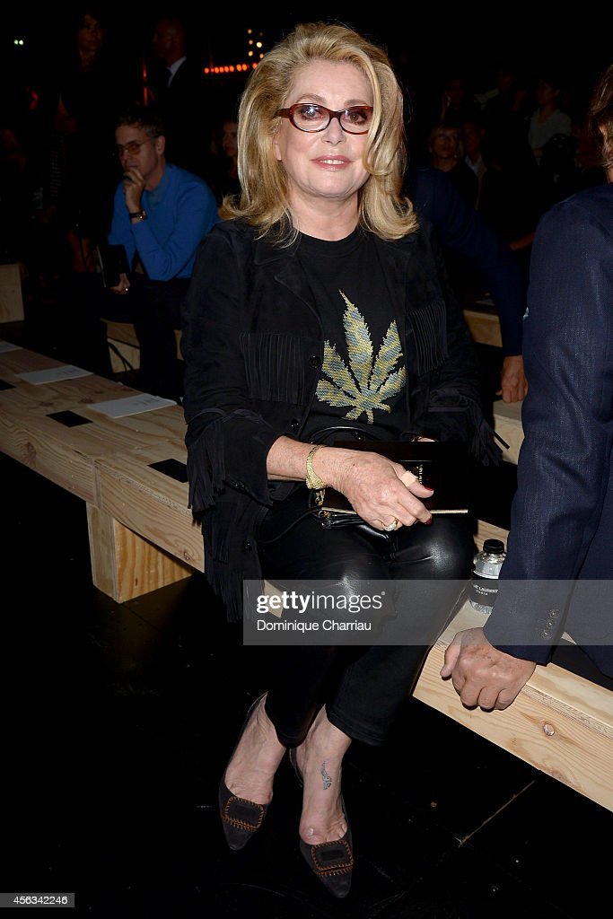 <a gi-track='captionPersonalityLinkClicked' href=/galleries/search?phrase=Catherine+Deneuve&family=editorial&specificpeople=123833 ng-click='$event.stopPropagation()'>Catherine Deneuve</a> attends the Saint Laurent show as part of the Paris Fashion Week Womenswear Spring/Summer 2015 on September 29, 2014 in Paris, France.