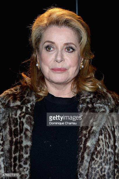 Catherine Deneuve attends the Saint Laurent show as part of the Paris Fashion Week Womenswear Fall/Winter 20142015 on March 3 2014 in Paris France