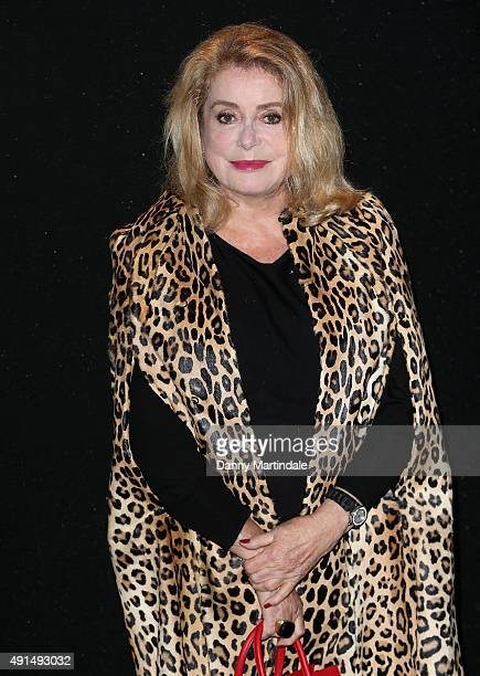 Catherine Deneuve attends the Saint Laurent show as part of the Paris Fashion Week Womenswear Spring/Summer 2016 on October 5 2015 in Paris France