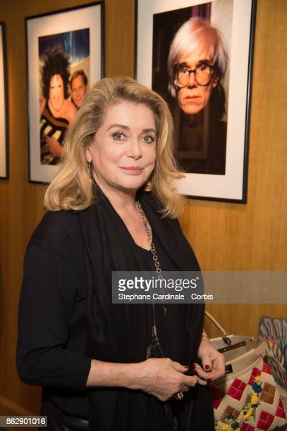 Catherine Deneuve attends the Simon Bocanegra and Philippe Morillon Exhibition at la Galerie Du passage Pierre Passebon on October 18 2017 in Paris...