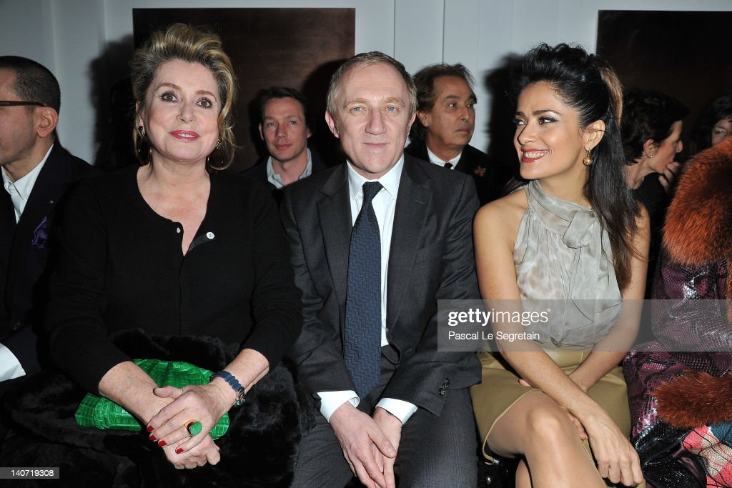<a gi-track='captionPersonalityLinkClicked' href=/galleries/search?phrase=Catherine+Deneuve&family=editorial&specificpeople=123833 ng-click='$event.stopPropagation()'>Catherine Deneuve</a>, <a gi-track='captionPersonalityLinkClicked' href=/galleries/search?phrase=Francois-Henri+Pinault&family=editorial&specificpeople=532174 ng-click='$event.stopPropagation()'>Francois-Henri Pinault</a> and <a gi-track='captionPersonalityLinkClicked' href=/galleries/search?phrase=Salma+Hayek&family=editorial&specificpeople=201844 ng-click='$event.stopPropagation()'>Salma Hayek</a> attend the Yves Saint-Laurent Ready-To-Wear Fall/Winter 2012 show as part of Paris Fashion Week on March 5, 2012 in Paris, France.