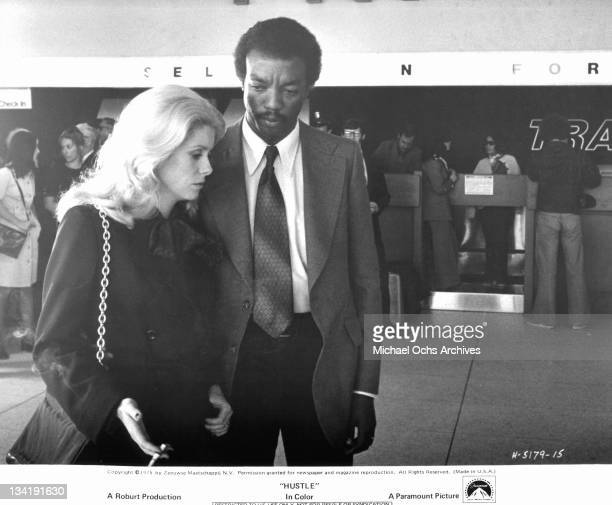 Catherine Deneuve gets tragic news from Paul Winfield in a scene from the film 'Hustle' 1975