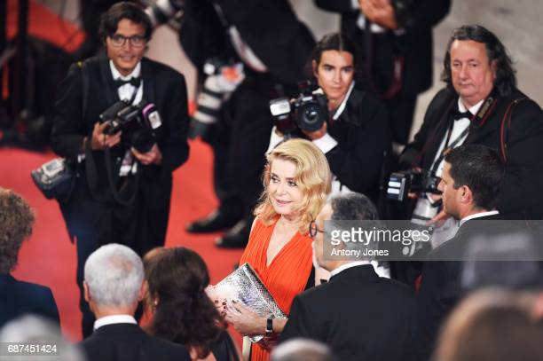 Catherine Deneuve leaves the 'Hikari ' screening during the 70th annual Cannes Film Festival at Palais des Festivals on May 23 2017 in Cannes France