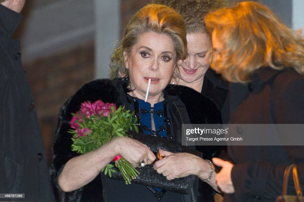 <a gi-track='captionPersonalityLinkClicked' href=/galleries/search?phrase=Catherine+Deneuve&family=editorial&specificpeople=123833 ng-click='$event.stopPropagation()'>Catherine Deneuve</a> leaves the 'In the Courtyard' (Dans la Cour) premiere during 64th Berlinale International Film Festival at Friedrichstadt-Palast on February 11, 2014 in Berlin, Germany.