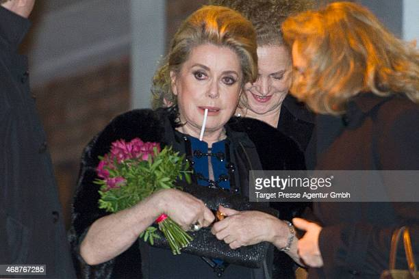 Catherine Deneuve leaves the 'In the Courtyard' premiere during 64th Berlinale International Film Festival at FriedrichstadtPalast on February 11...