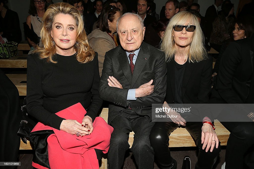 <a gi-track='captionPersonalityLinkClicked' href=/galleries/search?phrase=Catherine+Deneuve&family=editorial&specificpeople=123833 ng-click='$event.stopPropagation()'>Catherine Deneuve</a>, Pierre Berger and <a gi-track='captionPersonalityLinkClicked' href=/galleries/search?phrase=Betty+Catroux&family=editorial&specificpeople=765143 ng-click='$event.stopPropagation()'>Betty Catroux</a> attend the Saint Laurent Fall/Winter 2013 Ready-to-Wear show as part of Paris Fashion Week on March 4, 2013 in Paris, France.