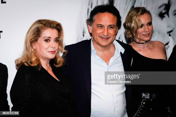 Catherine Deneuve Thierry Klifa and Diane Kruger attend the 'Tout nous separe' Premiere at UGC Cine Cite Bercy on October 19 2017 in Paris France