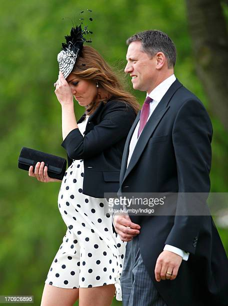 Catherine Duchess of Cambridge accompanied by her police protection officer attends the wedding of William van Cutsem and Rosie Ruck Keene at the...
