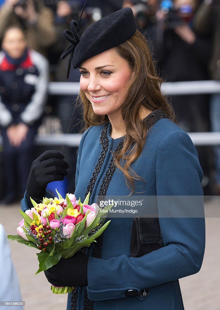 Catherine, Duchess of Cambridge accompanies Queen Elizabeth II and Prince Philip, Duke of Edinburgh on a visit to Baker Street Underground Station to mark the 150th anniversary of the London Underground on March 20, 2013 in London, England.