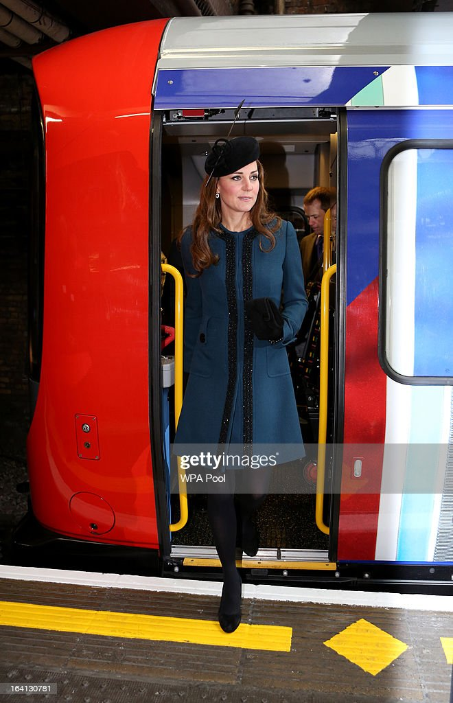 Catherine, Duchess of Cambridge alights from a train as she makes an official visit to Baker Street Underground Station, to mark 150th anniversary of the London Underground on March 20, 2013 in London, England.