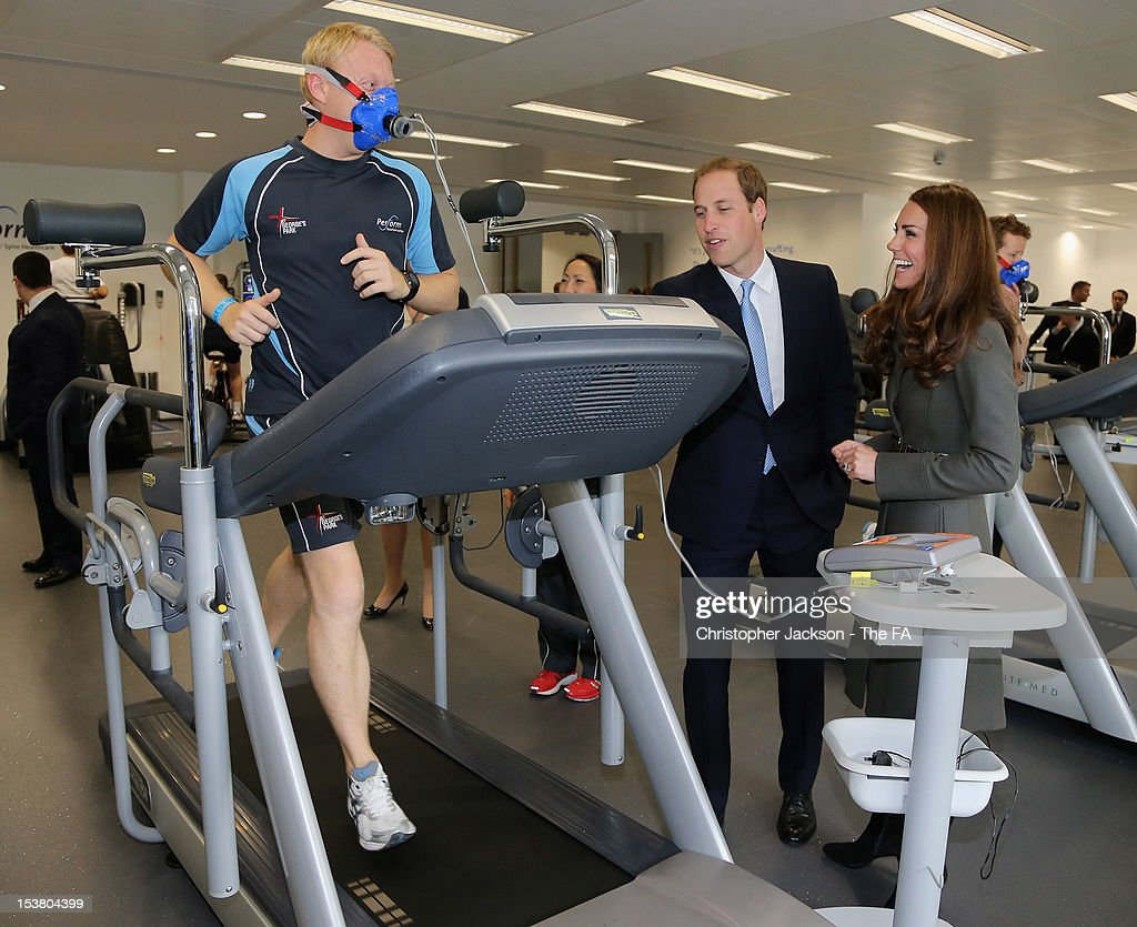 Catherine, Duchess of Cambridge alters the altitude and speed settings on a man's running machine as they visit the new gym during the official launch of The Football Association's National Football Centre at St George's Park on October 9, 2012 in Burton-upon-Trent, England.