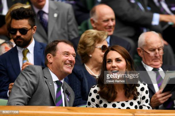 Catherine Duchess of Cambridge and AELTC Chairman Philip Brook in discussion on centre court on day one of the Wimbledon Lawn Tennis Championships at...