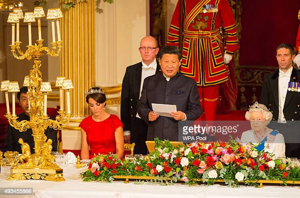 Catherine Duchess of Cambridge and Britain's Queen Elizabeth II listen as President of China Xi Jinping speaks during a state banquet at Buckingham...