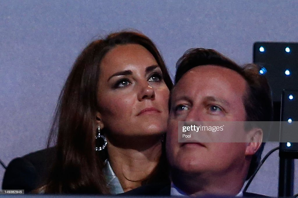 Catherine, Duchess of Cambridge, and British Prime Minister <a gi-track='captionPersonalityLinkClicked' href=/galleries/search?phrase=David+Cameron+-+Politician&family=editorial&specificpeople=227076 ng-click='$event.stopPropagation()'>David Cameron</a> look on during the Opening Ceremony of the London 2012 Olympic Games at the Olympic Stadium on July 27, 2012 in London, England.