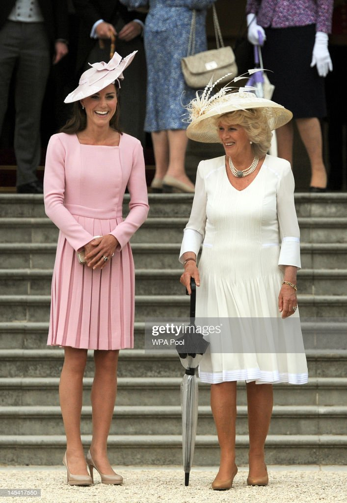 Catherine Duchess of Cambridge and Camilla Duchess of Cornwall attend a garden party at Buckingham Palace on May 29 2012 in London England