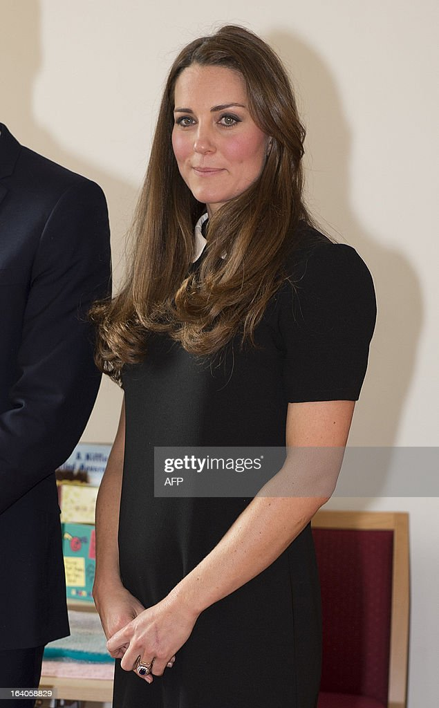 Catherine, Duchess of Cambridge, and her husband Prince William (unseen), Duke of Cambridge, visit the offices of Child Bereavement, in Saunderton, Buckinghamshire, on March 19, 2013.
