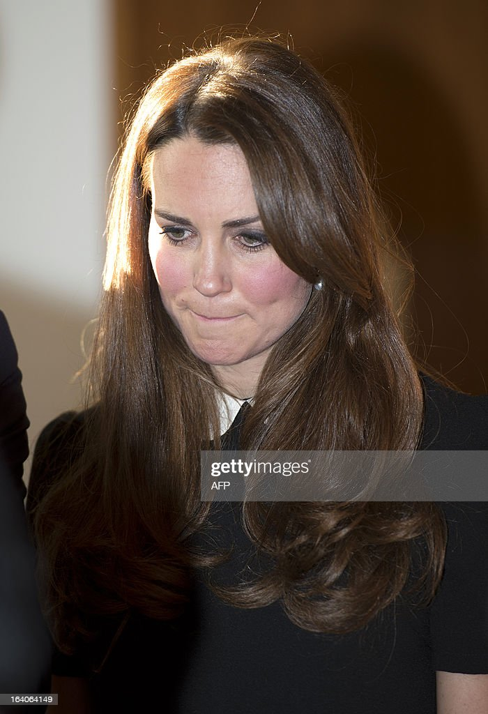 Catherine, Duchess of Cambridge, and her husband Prince William (unseen), Duke of Cambridge, visit the offices of Child Bereavement, in Saunderton, Buckinghamshire, on March 19, 2013. AFP PHOTO/POOL/PAUL EDWARDS