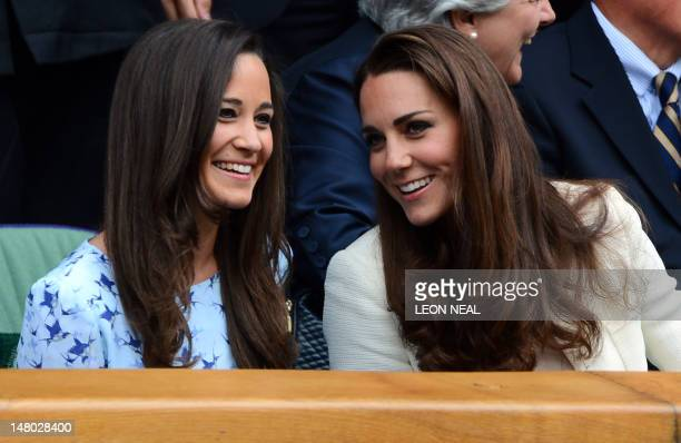 Catherine Duchess of Cambridge and her sister Pippa Middleton talk in the Royal Box before the men's singles final match between Britain's Andy...