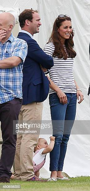 Catherine Duchess of Cambridge and her son Prince George attend the Royal Charity Polo during the Maserati Jerudong Trophy at Cirencester Park Polo...