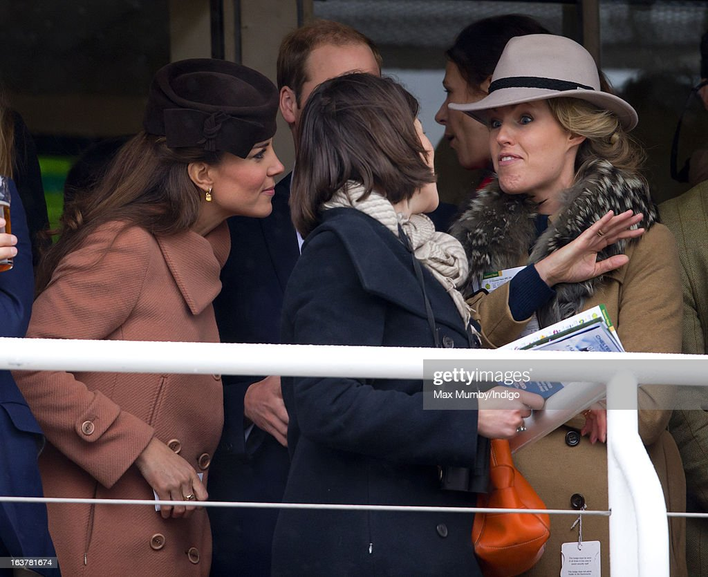 Catherine, Duchess of Cambridge and Marina Fogle watch the racing as she attends Day 4 of The Cheltenham Festival at Cheltenham Racecourse on March 15, 2013 in London, England.
