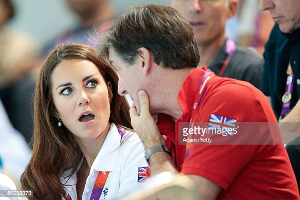 Catherine Duchess of Cambridge and official team GB ambassador Robin Cousins watch the Women's Teams Synchronised Swimming Technical Routine on Day...