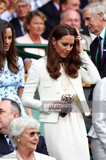Catherine Duchess of Cambridge and Pippa Middleton sit in the Royal Box during the Gentlemen's Singles final match between Roger Federer of...