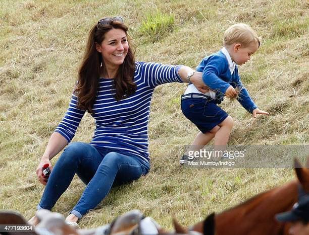 Catherine Duchess of Cambridge and Prince George of Cambridge attend the Gigaset Charity Polo Match at the Beaufort Polo Club on June 14 2015 in...