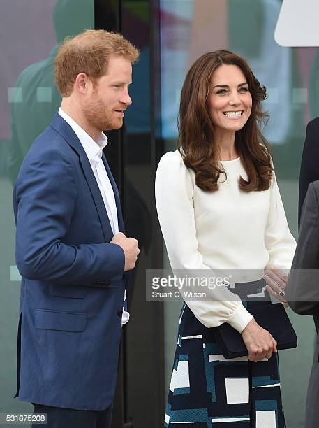Catherine Duchess of Cambridge and Prince Harry arrive to attend the launch of Heads Together Campaign at Olympic Park on May 16 2016 in London...