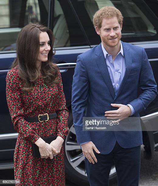 Catherine Duchess of Cambridge and Prince Harry attend a Christmas party for volunteers at The Mix youth service on December 19 2016 in London...