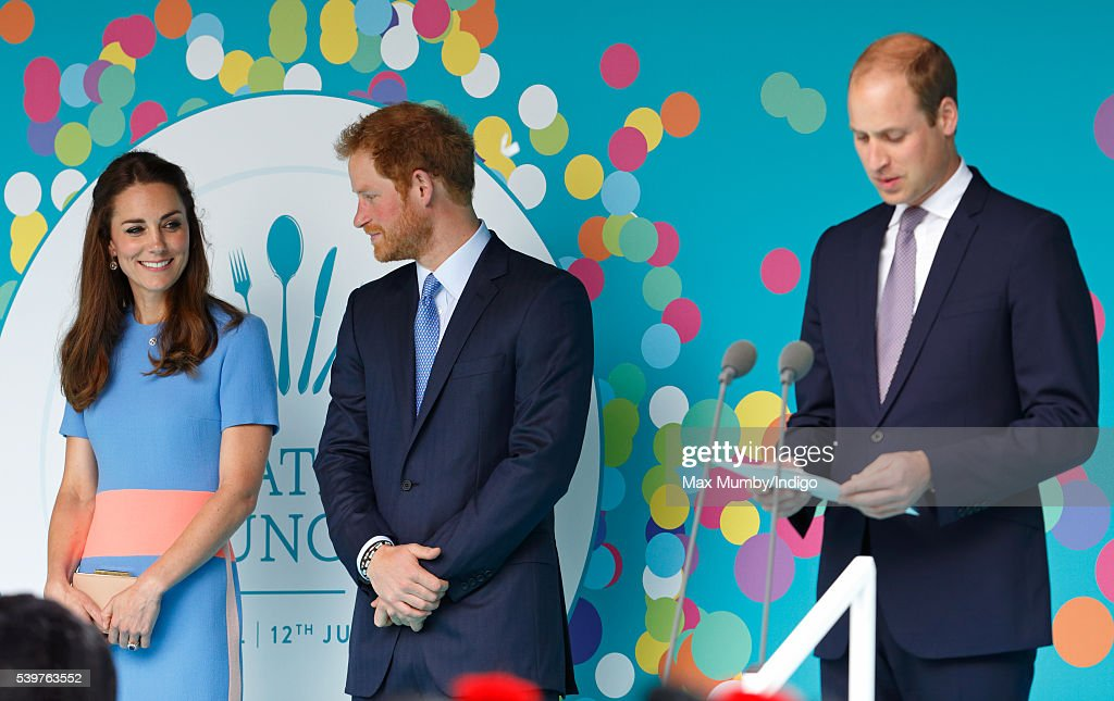 Catherine, Duchess of Cambridge and Prince Harry look on as Prince William, Duke of Cambridge makes a speech during 'The Patron's Lunch' celebrations to mark Queen Elizabeth II's 90th birthday on The Mall on June 12, 2016 in London, England.