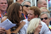 Catherine Duchess of Cambridge and Prince Harry look on during the Show Jumping Eventing Equestrian on Day 4 of the London 2012 Olympic Games at...