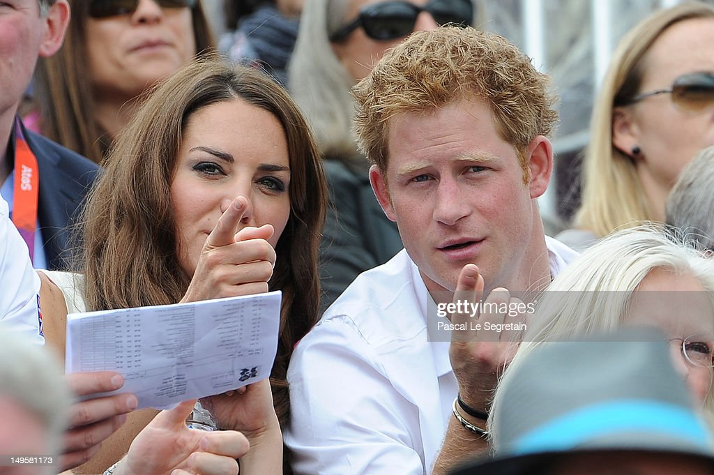 Catherine, Duchess of Cambridge and Prince Harry look on during the Show Jumping Eventing Equestrian on Day 4 of the London 2012 Olympic Games at Greenwich Park on July 31, 2012 in London, England.