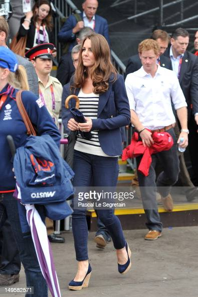 Catherine Duchess of Cambridge and Prince Harry walk to their seats prior to the Show Jumping Eventing Equestrian on Day 4 of the London 2012 Olympic...