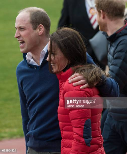 Catherine Duchess of Cambridge and Prince Wiliam Duke of Cambridge hug as they attend a training day for the Heads Together team for the London...