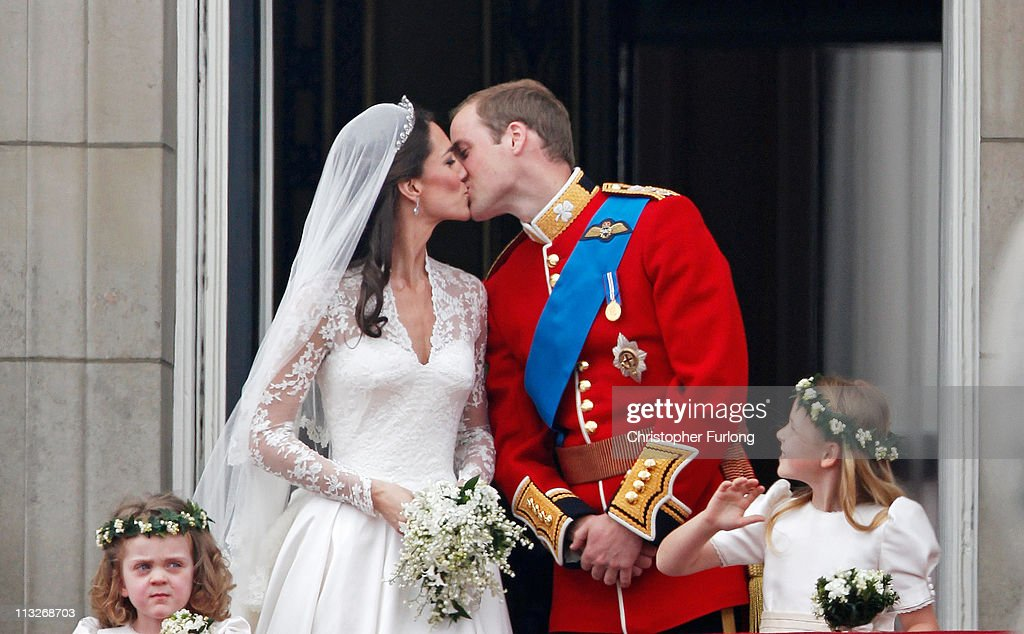 Catherine Duchess of Cambridge and Prince William Duke of Cambridge kiss on the balcony at Buckingham Palace on April 29 2011 in London England The...