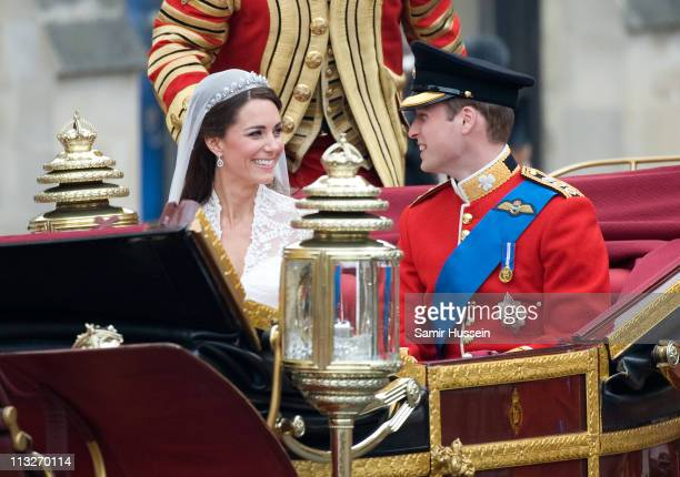 Catherine Duchess of Cambridge and Prince William Duke of Cambridge leave in a carriage after their Wedding at Westminster Abbey on April 29 2011 in...